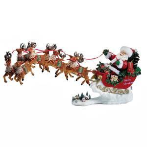Санта на оленях музыкальный